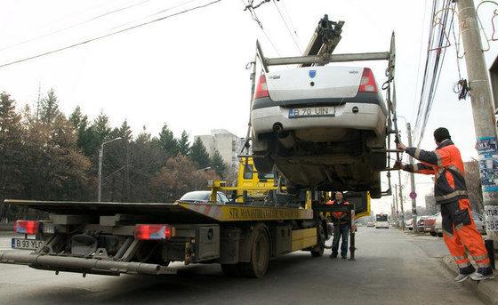 Masinile parcate neregulamentar nu pot fi ridicate in baza unei decizii a consiliului local